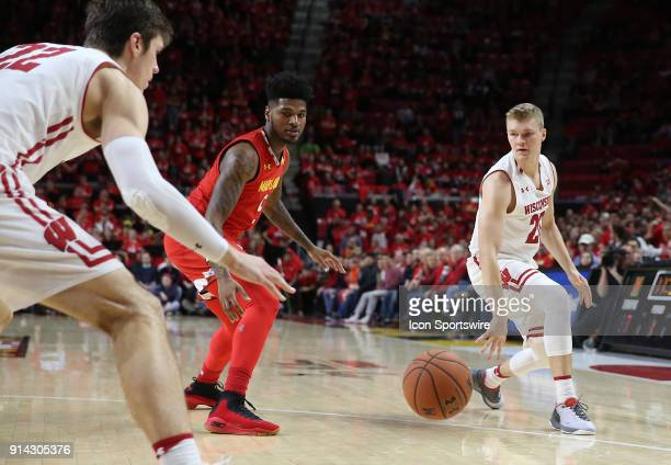Wisconsin Badgers guard TJ Schlundt bounces a pass to forward Ethan Happ during a Big 10 men's basketball game between the University of Maryland...
