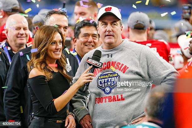 Wisconsin Badgers head coach Paul Chryst is interviewed by ESPN Sideline Reporter Allison Williams after the Goodyear Cotton Bowl Classic between...