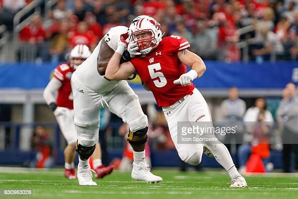 Wisconsin Badgers linebacker Garret Dooley works around Western Michigan Broncos offensive lineman Taylor Moton during the Goodyear Cotton Bowl...