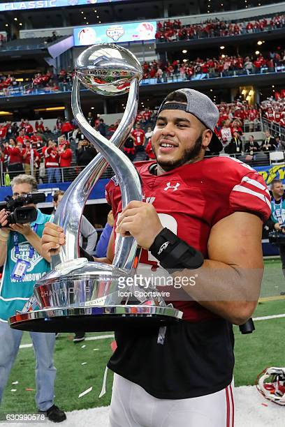 Wisconsin Badgers linebacker TJ Edwards holds the Goodyear Cotton Bowl Trophy after the 81st Goodyear Cotton Bowl Classic game between the Western...
