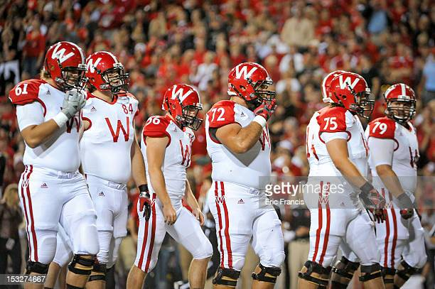 Wisconsin Badgers offense walk to the line against the Nebraska Cornhuskers during their game at Memorial Stadium on September 29 2012 in Lincoln...