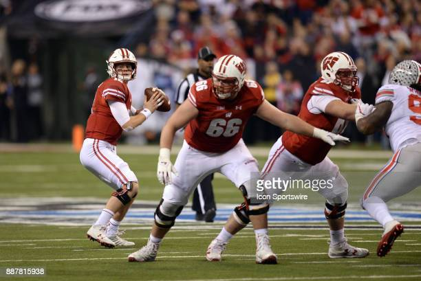Wisconsin Badgers offensive lineman Beau Benzschawel sets up for a block as Wisconsin Badgers quarterback Alex Hornibrook drops back for a pass...