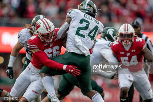 Wisconsin Badgers outside linebacker Zack Baun makes a tackle for loss on Michigan State Spartans running back Elijah Collins on 3rd down durning a...