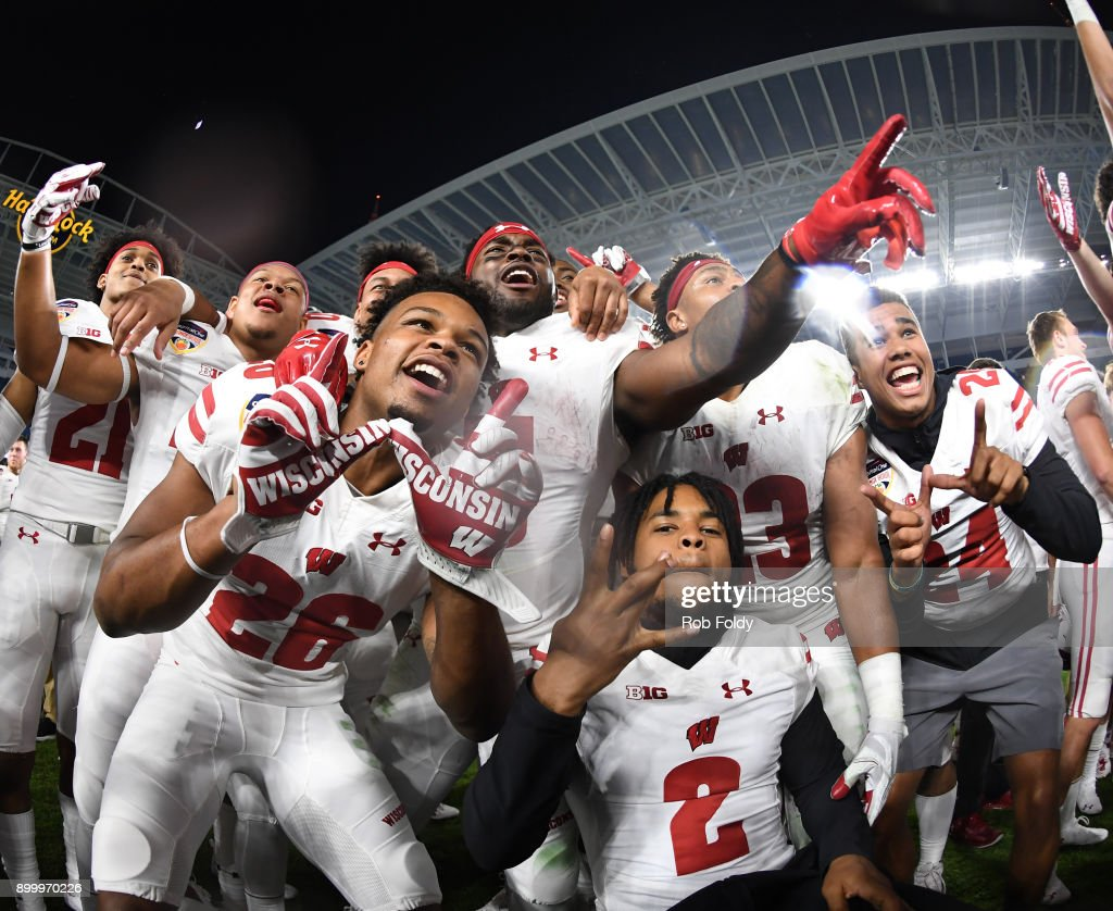 Wisconsin Badgers players celebrate winning the 2017 Capital One Orange Bowl against the Miami Hurricanes at Hard Rock Stadium on December 30, 2017 in Miami Gardens, Florida.