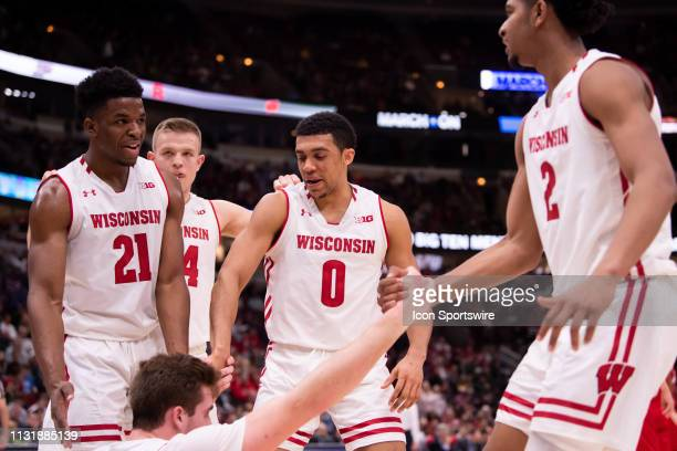 Wisconsin Badgers players huddle during a Big Ten Tournament quarterfinal game between the Nebraska Cornhuskers and the Wisconsin Badgers on March 15...