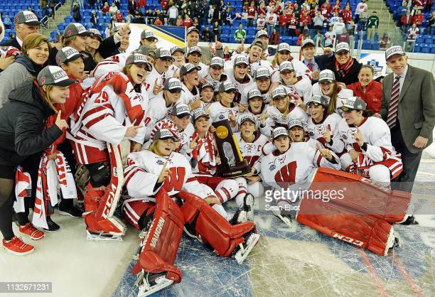 Wisconsin Badgers players take a team photo to celebrate their win over the Minnesota Golden Gophers in the Division I Women's Ice Hockey...