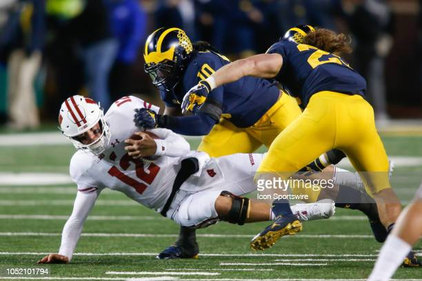 Wisconsin Badgers quarterback Alex Hornibrook is hit by Michigan Wolverines linebacker Devin Bush during a game between the Wisconsin Badgers and the...