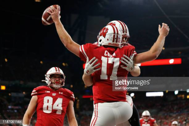 Wisconsin Badgers quarterback Jack Coan celebrates his touchdown in the end zone during the Big 10 Conference Championship game between the Wisconsin...
