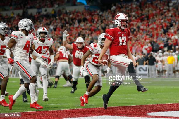Wisconsin Badgers quarterback Jack Coan celebrates his touchdown during the Big 10 Conference Championship game between the Wisconsin Badgers and...