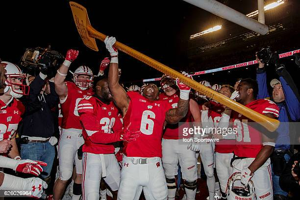 Wisconsin Badgers running back Corey Clement celebrates after chopping down the goal post after an NCAA Football game between the 6th ranked...