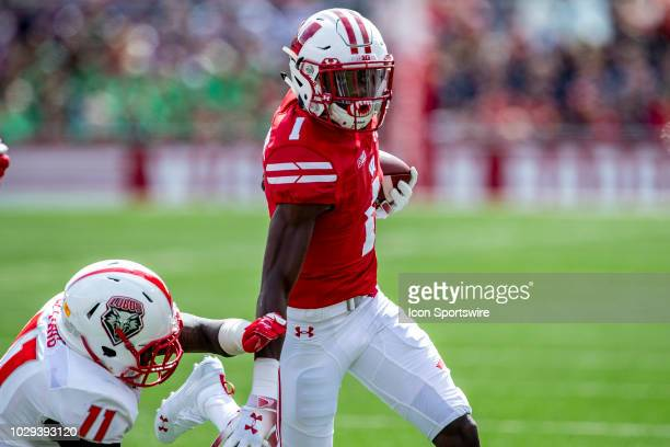 Wisconsin Badgers wide receiver Aron Cruickshank stiff arms New Mexico Lobos linebacker Rhashaun Epting on the end around during an college football...