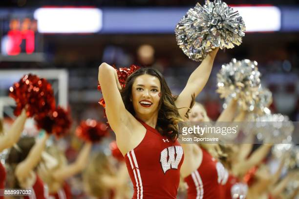 Wisconsin cheerleader during a college basketball game between the University of Wisconsin Badgers and the Marquette University Golden Eagles on...