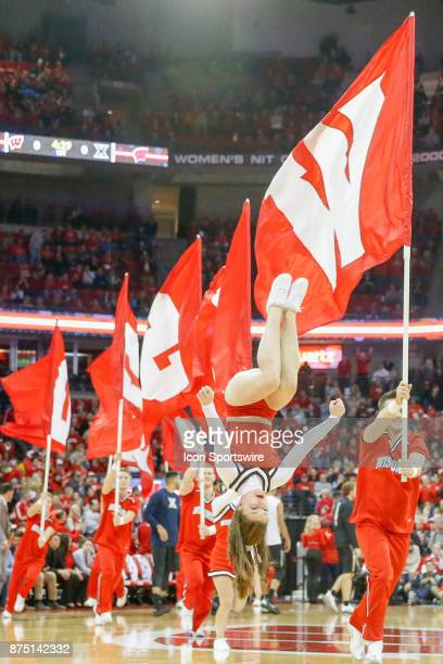 Wisconsin cheerleaders during a college basketball game between the University of Wisconsin Badgers and the Xavier University Musketeers on November...
