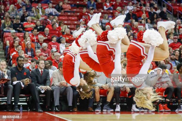 Wisconsin cheerleaders flip after a Wisconsin free throw during a Big Ten college basketball game between the University of Wisconsin Badgers and the...