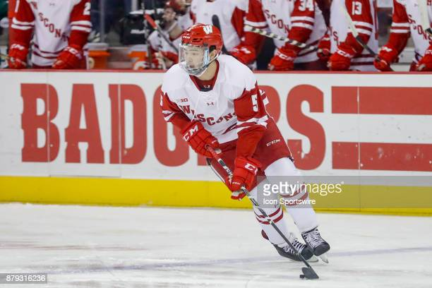 Wisconsin defenseman Tyler Inamoto stick handles the puck during a college hockey game between the University of Wisconsin Badgers and the Mercyhurst...