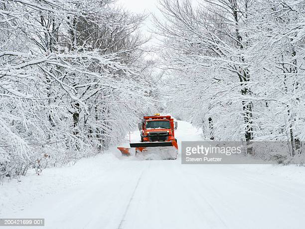 usa, wisconsin, door county, snow plow driving down road - snowplow stock pictures, royalty-free photos & images