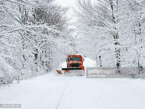 usa, wisconsin, door county, snow plow driving down road - schneefahrzeug stock-fotos und bilder