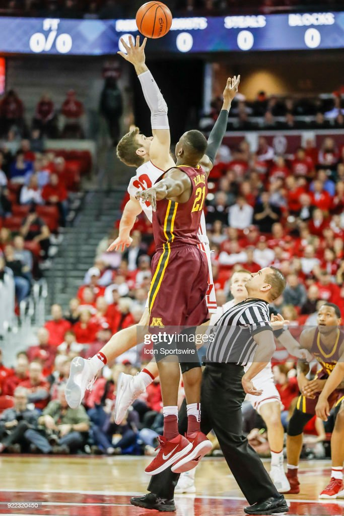 Wisconsin forward Ethan Happ (22) and Minnesota center Bakary Konate (21) at the tip off during a college basketball game between the University of Wisconsin Badgers and the University of Minnesota Golden Gophers on February 19, 2018 at the Kohl Center in Madison, WI. Wisconsin defeated Minnesota by a score of 73 - 63.