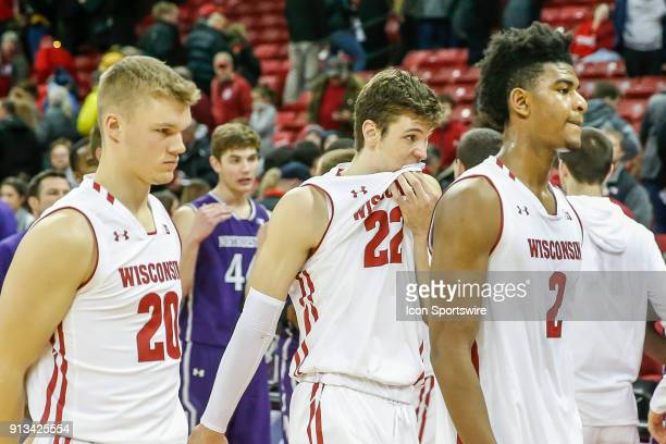 Wisconsin forward Ethan Happ Wisconsin guard TJ Schlundt and Wisconsin forward Aleem Ford leave the court following a college basketball game between...