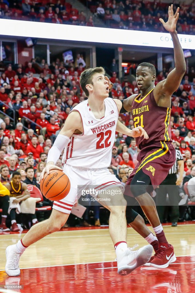 Wisconsin forward Ethan Happ (22) works his way under the basket past Minnesota center Bakary Konate (21) during a college basketball game between the University of Wisconsin Badgers and the University of Minnesota Golden Gophers on February 19, 2018 at the Kohl Center in Madison, WI. Wisconsin defeated Minnesota by a score of 73 - 63.