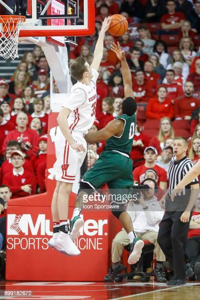 Wisconsin forward Nate Reuvers blocks a shot by Chicago State guard Glen Burns during a college basketball game between the University of Wisconsin...