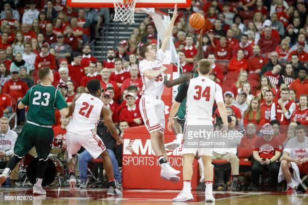 Wisconsin forward Nate Reuvers blocks a shot during a college basketball game between the University of Wisconsin Badgers and the Chicago State...