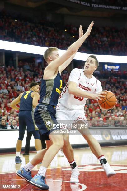 Wisconsin forward Nate Reuvers can't find an opening during a college basketball game between the University of Wisconsin Badgers and the Marquette...
