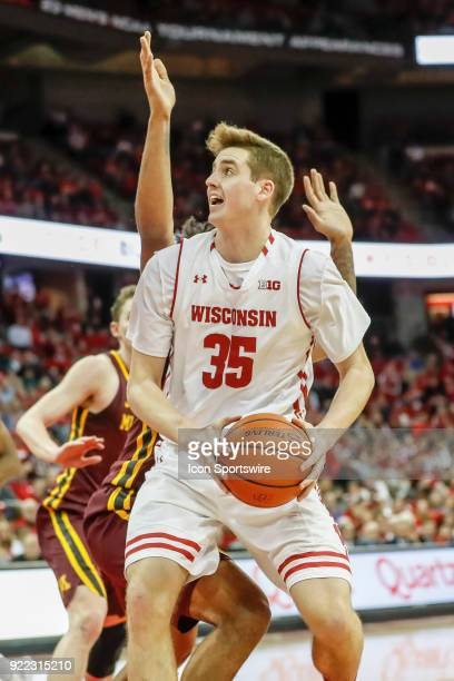 Wisconsin forward Nate Reuvers goes up for a shot during a college basketball game between the University of Wisconsin Badgers and the University of...