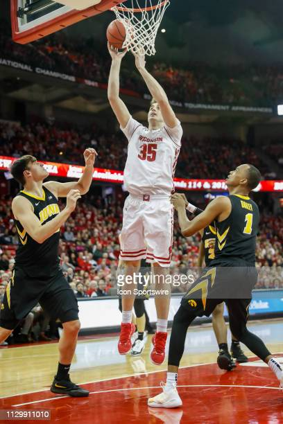 Wisconsin forward Nate Reuvers puts up a shot during a college basketball game between the University of Wisconsin Badgers and the University of Iowa...