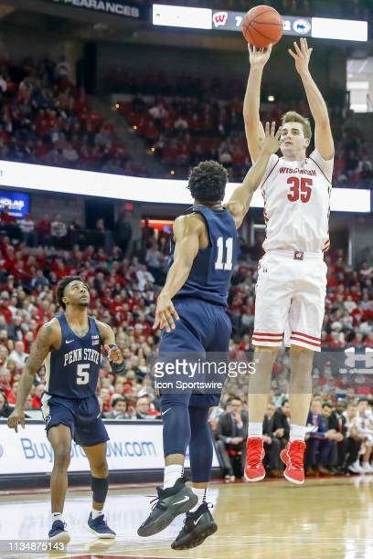 Wisconsin forward Nate Reuvers puts up a shot over Penn State University forward Lamar Stevens during a college basketball game between the...