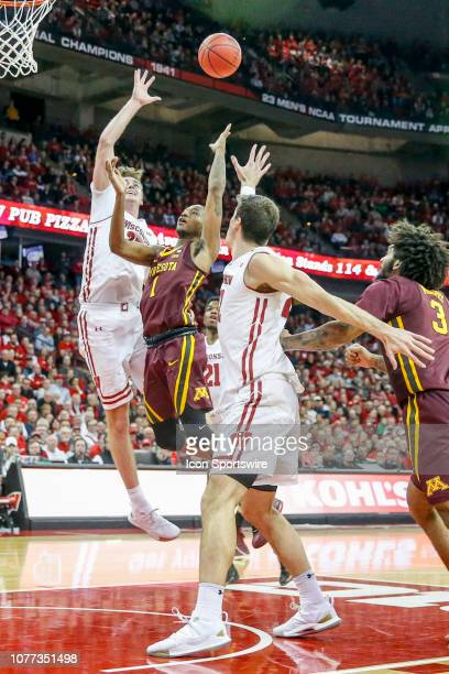 Wisconsin forward Nate Reuvers tries to block a shot by Minnesota guard Dupree McBrayer during a college basketball game between the University of...