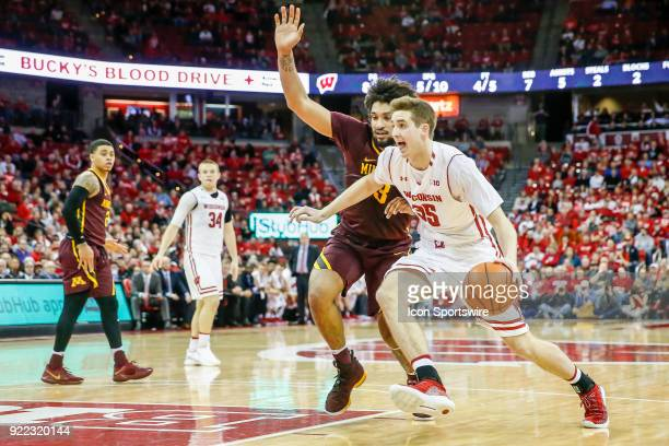 Wisconsin forward Nate Reuvers tries to go around Minnesota forward Jordan Murphy during a college basketball game between the University of...