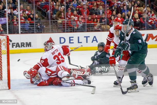 Wisconsin goalie Kyle Hayton watches the puck rebound out of the goal after Michigan State right wing Mitchell Lewandowski scored the game winning...