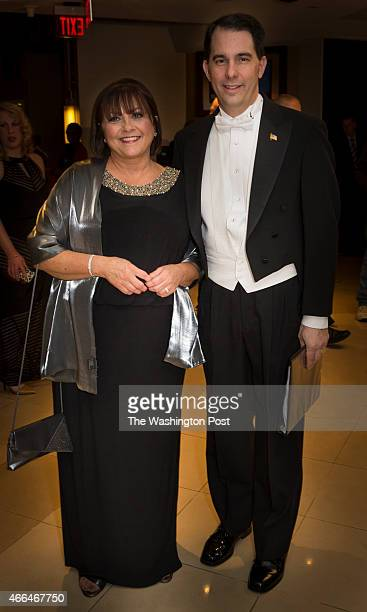 Wisconsin Gov Scott Walker and his wife Tonette arrive at the Gridiron Club Dinner at the Renaissance Hotel in Washington DC on March 14 2015 The...