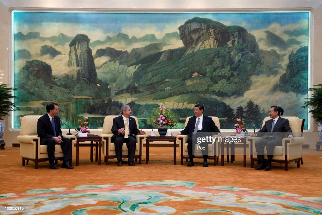 Wisconsin Gov. Scott Walker and Iowa Gov. Terry Branstad meet with Chinese President Xi Jinping and Foreign Minister Wang Yi during a meeting at the Great Hall of the People on April 15, 2013 in Beijing, China. Walker is in China to lead his first trade mission overseas and hopes to build a relationship with China to increase both imports and exports in the future. He along with other American governors will attend a National Governor's Association meeting.