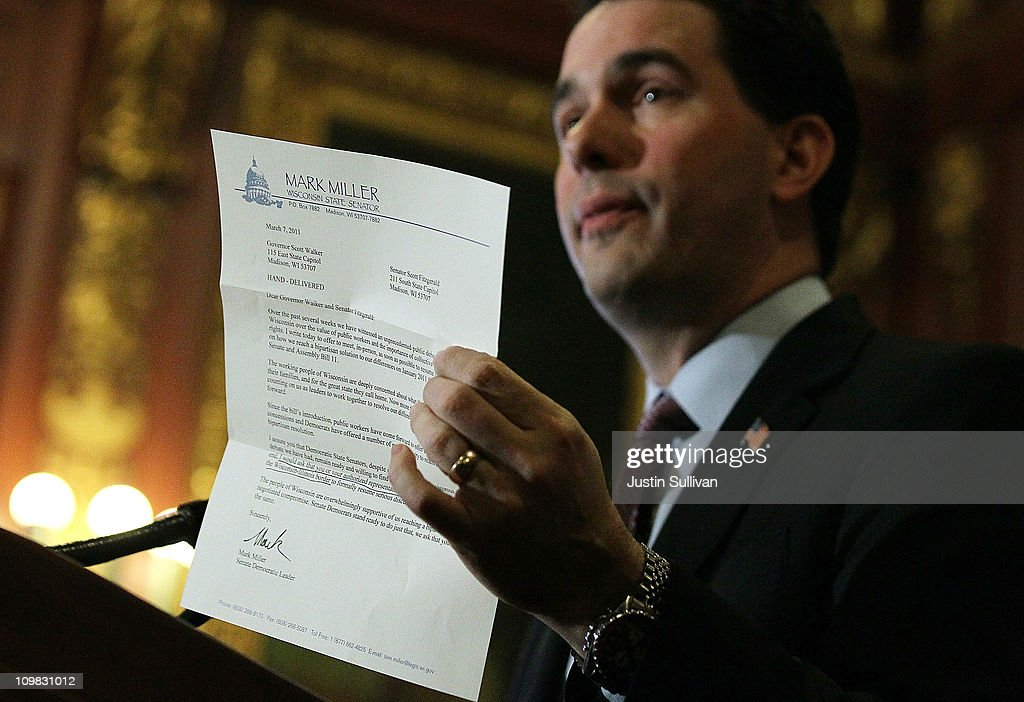 Wisconsin Gov. Scott Walker holds a letter from democratic State Sen. Mark Miller, one of the fourteen Wisconsin state senators who fled the state over two weeks ago, during a press conference on March 7, 2011 in Madison, Wisconsin. Governor Walker criticized democrat State senators of misleading the public and standing in the way of breaking an budget impasse that has 14 Senate Democrats hiding out in Illinois. The letter requested a meeting near the Wisconsin and Illinois borders following a report that the Democrats would return to the capitol.