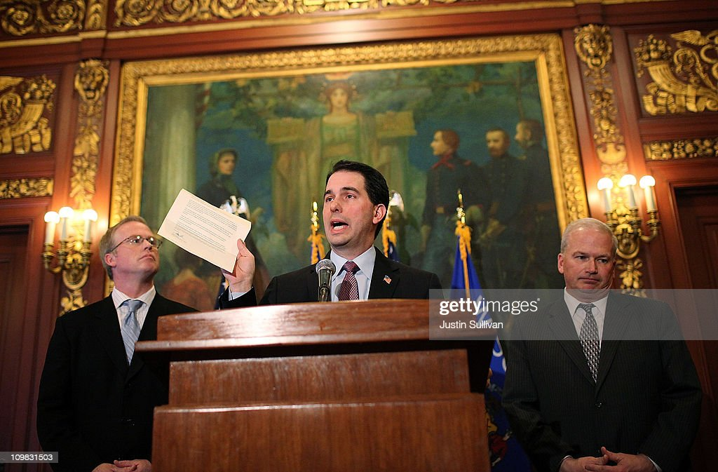 Wisconsin Gov. Scott Walker (C) holds a letter from democratic State Sen. Mark Miller, one of the fourteen Wisconsin state senators who fled the state over two weeks ago, as republican State senator Scott Fitzgerald (R) and republican Speaker of the House Jeff Fitgerald (L) look on during a press conference on March 7, 2011 in Madison, Wisconsin. Governor Walker criticized Democratic state senators of misleading the public and standing in the way of breaking an budget impasse that has 14 Senate Democrats hiding out in Illinois. The letter requested a meeting near the Wisconsin and Illinois borders following a report that the Democrats would return to the capitol.
