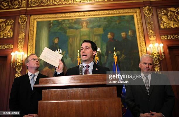 Wisconsin Gov Scott Walker holds a letter from democratic State Sen Mark Miller one of the fourteen Wisconsin state senators who fled the state over...