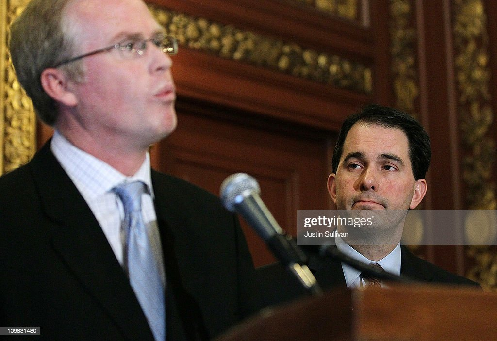 Wisconsin Gov. Scott Walker (R) looks on as Speaker of the House Jeff Fitzgerald speaks during a press conference with at the Wisconsin State Capitol on March 7, 2011 in Madison, Wisconsin. Wisconsin governor Walker criticized Democratic state senators of misleading the public and standing in the way of breaking an budget impasse that has 14 Senate Democrats hiding out in Illinois. The letter requested a meeting near the Wisconsin and Illinois borders following a report that the Democrats would return to the capitol.