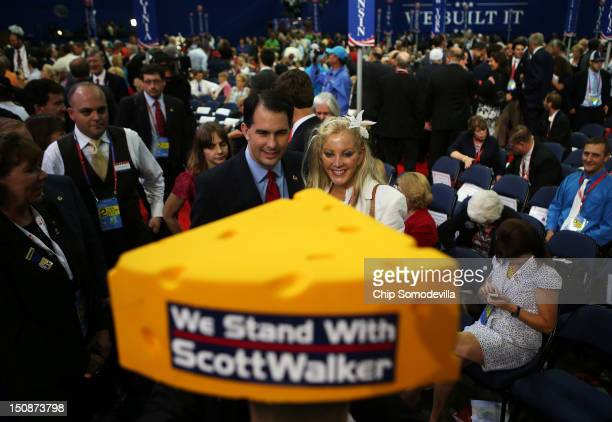 Wisconsin Gov. Scott Walker poses with a woman during the Republican National Convention at the Tampa Bay Times Forum on August 28, 2012 in Tampa,...