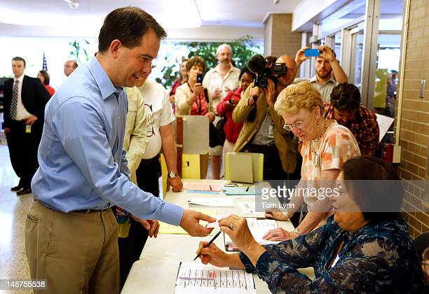 Wisconsin Gov Scott Walker prepares to cast his ballot at Jefferson School to vote in the gubernatorial recall election June 5 2012 in Wauwatosa...