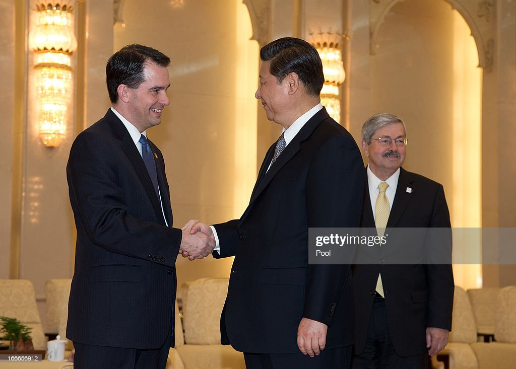 Wisconsin Gov. Scott Walker (L) shaeks hands with Chinese President Xi Jinping as Iowa Gov. Terry Branstad looks on before a meeting at the Great Hall of the People on April 15, 2013 in Beijing, China. Walker is in China to lead his first trade mission overseas and hopes to build a relationship with China to increase both imports and exports in the future. He along with other American governors will attend a National Governor's Association meeting.