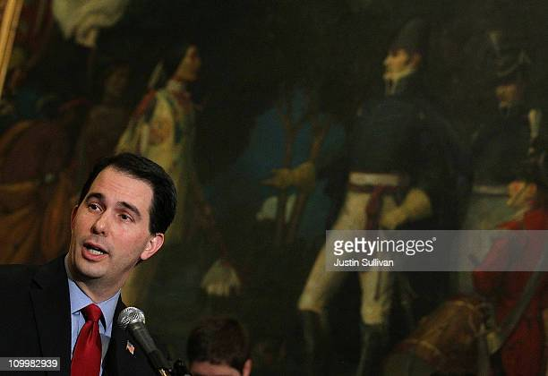 Wisconsin Gov Scott Walker speaks during a ceremonial bill signing outside his office at the Wisconsin State Capitol on March 11 2011 in Madison...