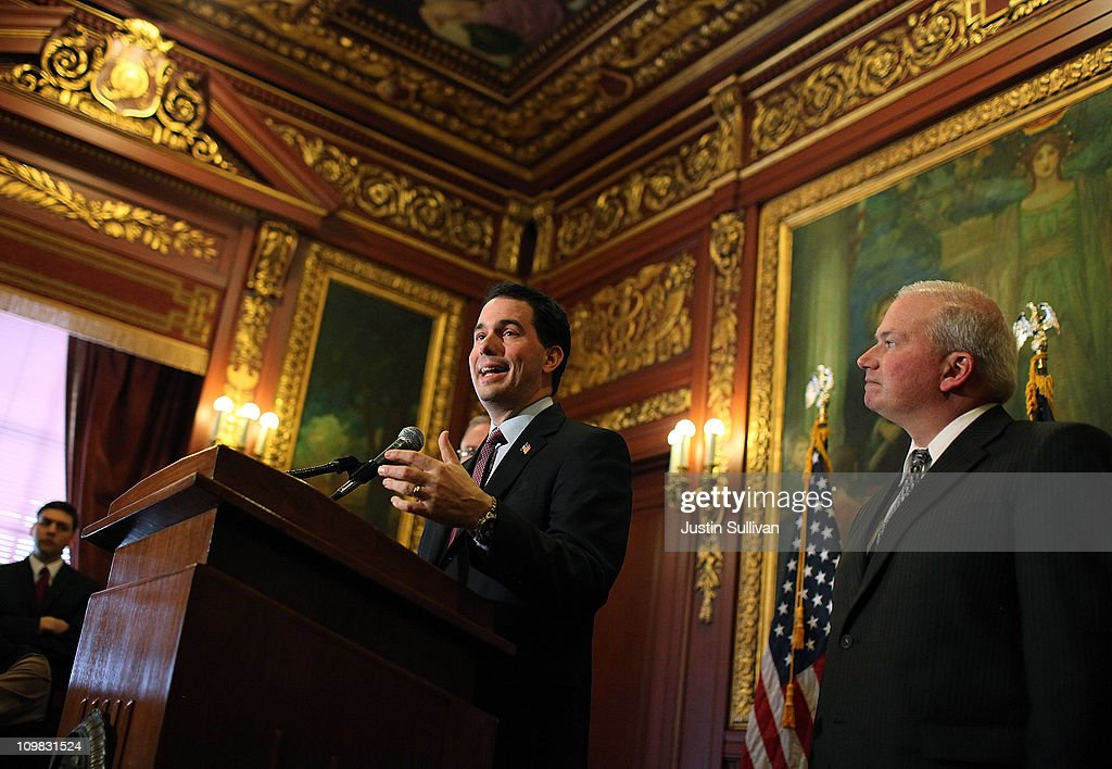 Wisconsin Gov. Scott Walker (L) speaks during a press conference as republican State senator Scott Fitzgerald (R) looks on March 7, 2011 in Madison, Wisconsin. Governor Walker criticized Democratic state senators of misleading the public and standing in the way of breaking an budget impasse that has 14 Senate Democrats hiding out in Illinois. The letter requested a meeting near the Wisconsin and Illinois borders following a report that the Democrats would return to the capitol.