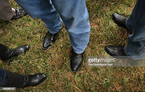 Wisconsin Governor Scott Walker and Virginia Gubernatorial candidate Ken Cuccinelli wears jeans and black cowboy boots as they talk with voters at a...