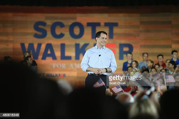 Wisconsin Governor Scott Walker announces to supporters and news media gathered at the Waukesha County Expo Center that he will seek the Republican...