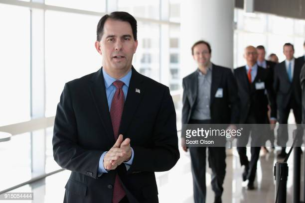 Wisconsin Governor Scott Walker arrives at an event held to announce Foxconn's plan to purchase an office building from Northwestern Mutual on...