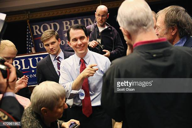 Wisconsin Governor Scott Walker greets guests at a rally with US Rep Rod Blum on April 24 2015 in Cedar Rapids Iowa Walker is considered a potential...