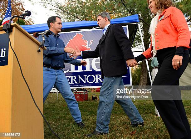 Wisconsin Governor Scott Walker introduces Virginia Gubernatorial candidate Ken Cuccinelli at a campaign rally in Woodbridge Virginia on November 2...