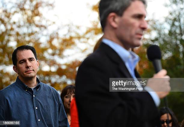 Wisconsin Governor Scott Walker listens to Virginia Gubernatorial candidate Ken Cuccinelli at a campaign rally in Woodbridge Virginia on November 2...